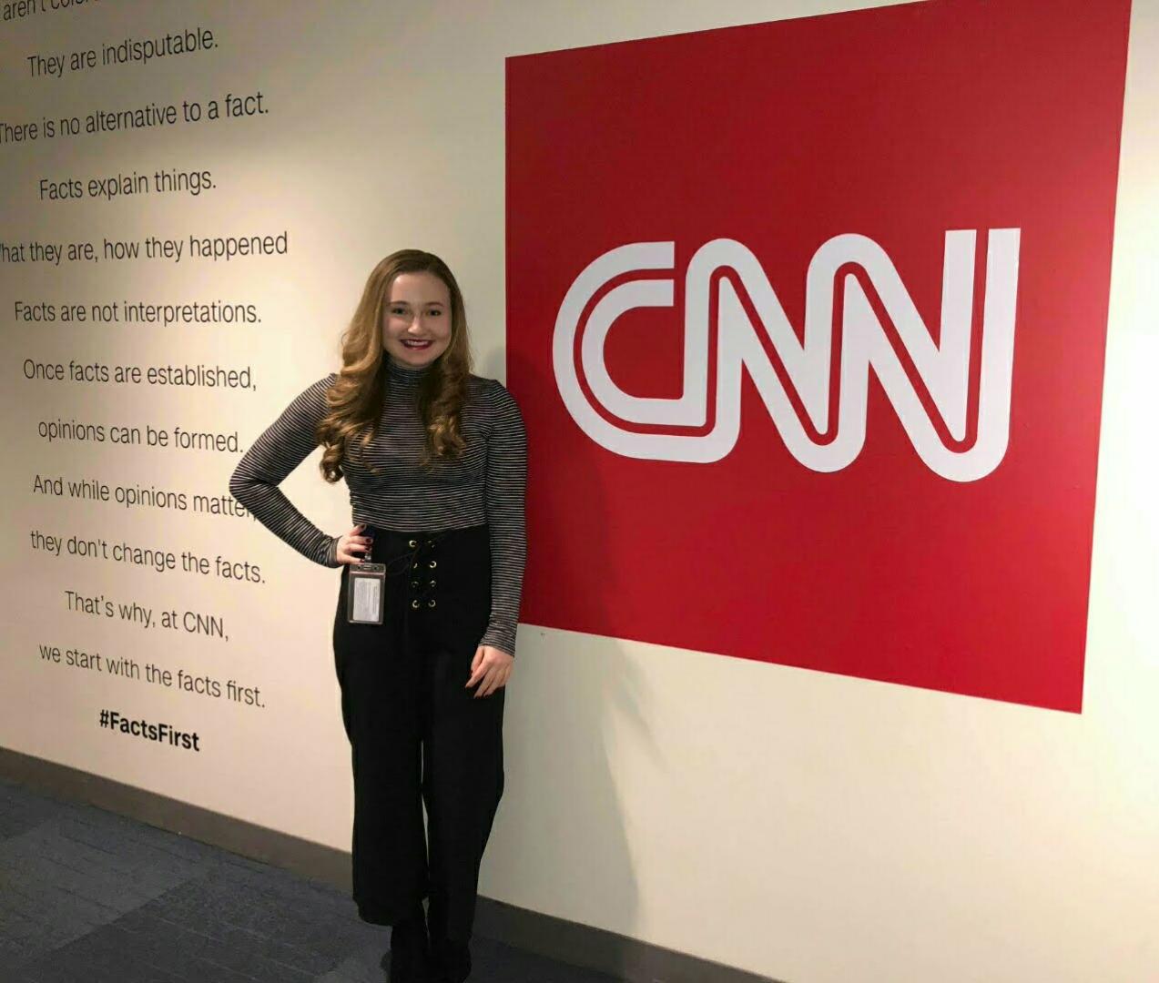 Annmarie Gajdos in front of CNN logo-wall