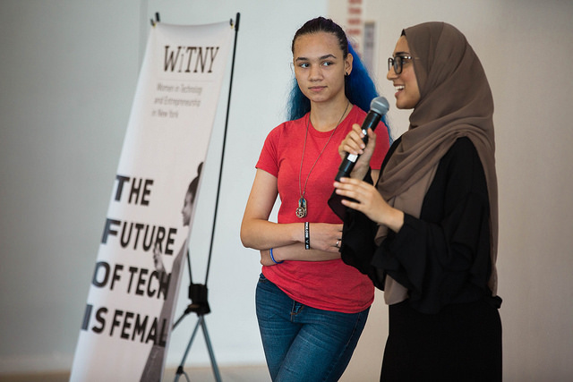 2 WiTNY students speaking to a crowd