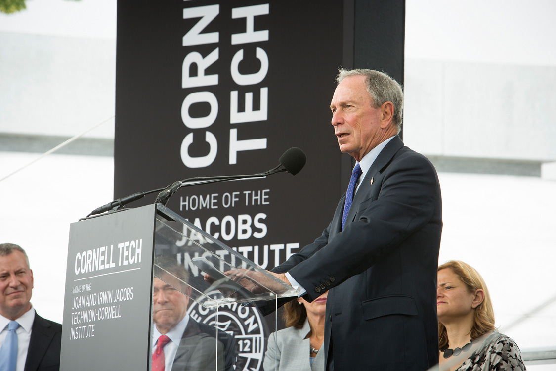 Michael Bloomberg speaking at a podium