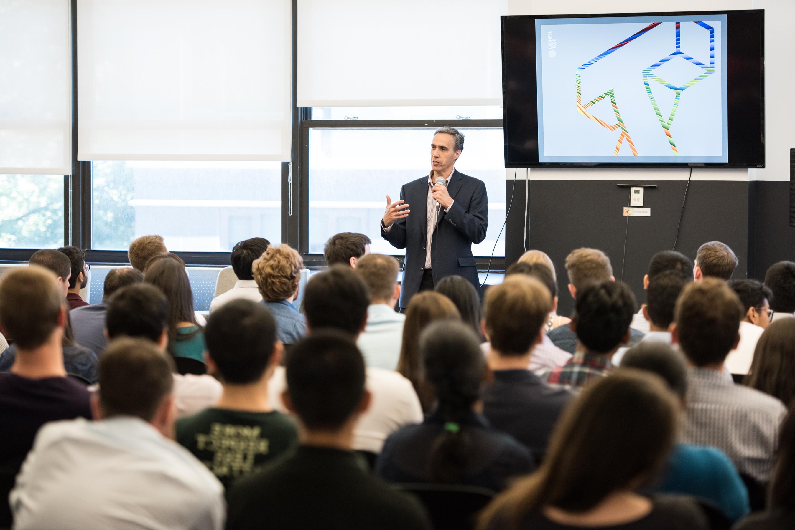 Daniel Huttenlocher speaking to a room full of students